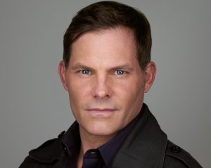 Headshot of actor looking for James Bond type roles