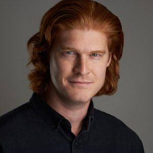 Handsome red haired Ft Worth man with a gleam in his eye